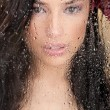 Royalty-Free Stock Photo: Woman\'s face behind glass full of water drops