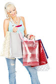 Bags and credit card in her hands — Stock Photo