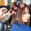 Pinching client's curlers - Stock Photo