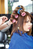 Pinching client's curlers — Stock Photo