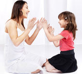 Woman and child laughing and playing — Stock Photo
