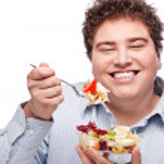 Chubby man with fresh salad — Stock Photo