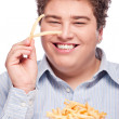 Chubby man with pommes frites — Stock Photo