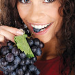 Pretty girl eating grape — Stock Photo