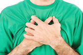 Both man's hands on breast because of hard breathing — Stockfoto
