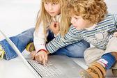 Children turning on computer — Stock Photo
