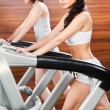 Exercise in gym center — Stock Photo