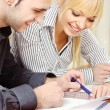Young business couple work in office - Stock Photo