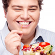 Chubby man with fresh salad - Stock Photo