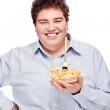 Chubby man with French fries — Stock Photo #8275559