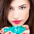 Pretty woman with blue rocks — Stock Photo #8309020