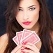 Pretty woman holding cards — Stock Photo #8309026