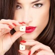 Young woman holding dices — Stock Photo #8309030