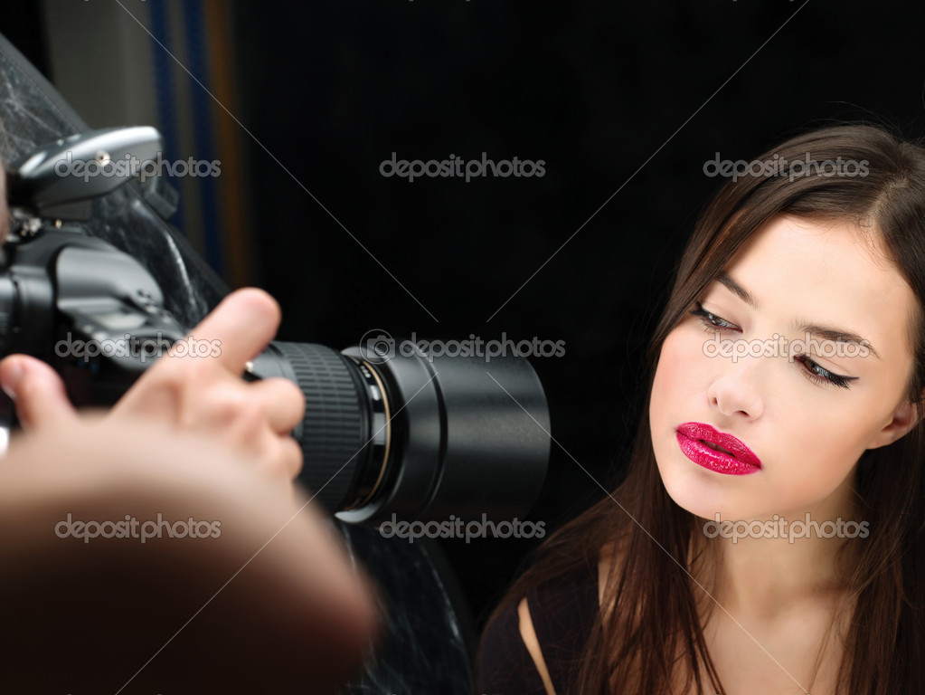 Pretty female model on photo shooting in studio — Stock Photo #8309033