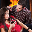 Couple in love enjoying wine near fireplace — Stock Photo
