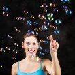 Happy girl and soap bubbles - Stok fotoraf