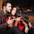 Happy couple near fireplace — Stock Photo #8434931
