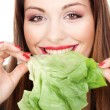 Stock Photo: Woman eating green salad