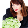 Woman offering green salad — Stock Photo