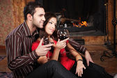 Happy couple near fireplace — Stock Photo
