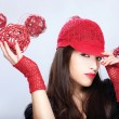 Woman with red hat holding red ball — Stock Photo