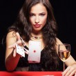 Womgambling on red table — Foto de stock #8499738