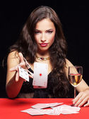Woman gambling on red table — Stok fotoğraf