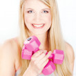 Smiled woman holding two weights — Stock Photo #8508365