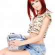 Red hair teenage girl holding CD player — Stock Photo #8538641