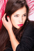 Lady in front of red feather — Stock Photo