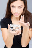 Woman hold contact lenses cases and lens — Stock Photo