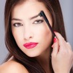 Постер, плакат: Woman combing eyebrow