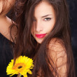 Long hair and yellow daisy — Photo