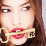 Woman holding big old key — Stock Photo