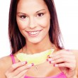 Woman holding slice of yellow melon — Stock Photo #8605683