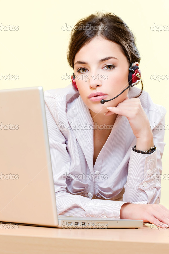 Pretty female operator near computer — Stock Photo #8605598
