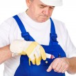Middle age worker putting cream on his wound — Stock Photo