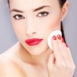 Woman applying makeup — Stock Photo