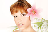 Woman with flower in hair — Stock Photo