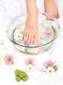 Feet in aromatherapy bowl — Stock Photo