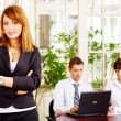 Handsome female manager with employers in office — Stock Photo #9010310