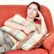 Woman on sofa having headache — Stock Photo