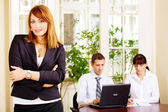 Handsome female manager with employers in office — Stock Photo