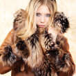 Blond woman with fur coat — Stock Photo