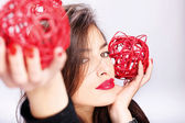 Woman holding two red balls — Stock Photo