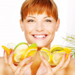 Happy woman with two fruit bowl — Stock Photo