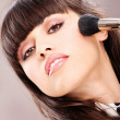 Stock Photo: Pretty womdoing make up