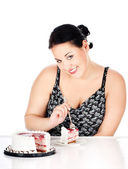 Slice of cake and chubby woman — Stock Photo