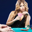 Woman doubt in a card gambling match - Stock Photo