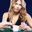 Woman doubt in a card gambling match - Foto Stock